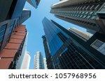 the glass walls of modern... | Shutterstock . vector #1057968956
