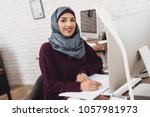 arab woman in hijab working in... | Shutterstock . vector #1057981973