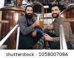 two bearded brewers cooked... | Shutterstock . vector #1058007086