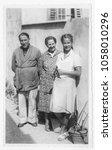 parent with daughter in 1942 | Shutterstock . vector #1058010296