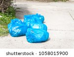 garbage on the urban street in... | Shutterstock . vector #1058015900