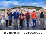 group of tourists watching the... | Shutterstock . vector #1058030936