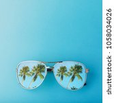 sunglasses with palm trees... | Shutterstock . vector #1058034026