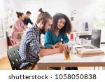 in the office. creative young... | Shutterstock . vector #1058050838