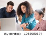in the office. a young multi... | Shutterstock . vector #1058050874