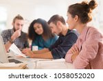 in the office. meeting around a ... | Shutterstock . vector #1058052020