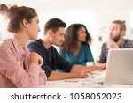 in the office. meeting around a ... | Shutterstock . vector #1058052023