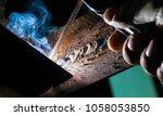 welder closeup hand   Shutterstock . vector #1058053850