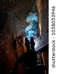 welder closeup spark   Shutterstock . vector #1058053946