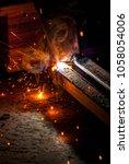welder closeup spark   Shutterstock . vector #1058054006