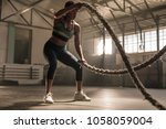 fitness woman using training... | Shutterstock . vector #1058059004