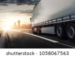 truck delivers in city | Shutterstock . vector #1058067563