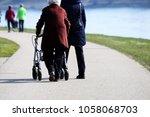 senior citizen talking a walk | Shutterstock . vector #1058068703