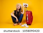 happy young woman in a hat... | Shutterstock . vector #1058090420
