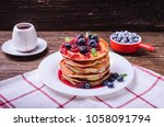 stack of american pancakes with ... | Shutterstock . vector #1058091794
