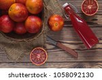 blood orange fruit in a wicker... | Shutterstock . vector #1058092130