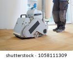 sanding hardwood floor with the ... | Shutterstock . vector #1058111309