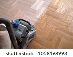 sanding hardwood floor with the ... | Shutterstock . vector #1058168993