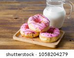 Donuts With Milk On Wooden Table