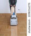 sanding hardwood floor with the ... | Shutterstock . vector #1058216270