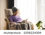 senior woman reading a book and ... | Shutterstock . vector #1058224304