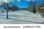 skiers on the boyneland lift at ... | Shutterstock . vector #1058227700