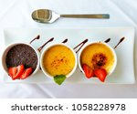 three cups with creme brulee ... | Shutterstock . vector #1058228978