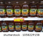 Small photo of Shah Alam , Malaysia - 24 March 2018 : ALIF brand vagetable cooking oil display for sell on the supermarket shelf.Mobile photoghpy.