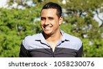 smiling adult hispanic male | Shutterstock . vector #1058230076