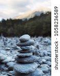 inukshuk rock pile cairn trail... | Shutterstock . vector #1058236589