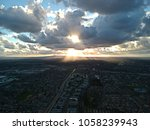 Sun Peeking Through The Clouds