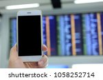 hand holding mockup smartphone... | Shutterstock . vector #1058252714