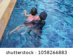 kid playing and swim in a small ... | Shutterstock . vector #1058266883