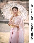 beautiful thai woman wearing... | Shutterstock . vector #1058294204