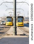 Small photo of Budapest, Hungary - December 29, 2017: Two modern yellow trams passing each other on Margaret bridge