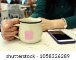 cup of tea. in the cafe place.... | Shutterstock . vector #1058326289