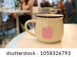 cup of tea. in the cafe place.... | Shutterstock . vector #1058326793