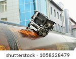 automatic pipe quality control. ... | Shutterstock . vector #1058328479