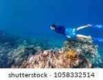 underwater photo of a young man ... | Shutterstock . vector #1058332514