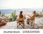 romantic couple on safari... | Shutterstock . vector #1058334500
