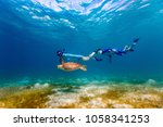 underwater photo of family... | Shutterstock . vector #1058341253