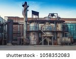old refinery tank with blue sky | Shutterstock . vector #1058352083