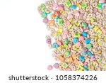 Stock photo frosted toasted oat cereal with fun shaped marshmallows on white background blank space for texts 1058374226