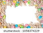 Stock photo frosted toasted oat cereal with fun shaped marshmallows on white background blank space for texts 1058374229