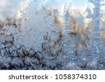 frost on window glass close up...   Shutterstock . vector #1058374310