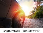 suv rides on a mountain dirt... | Shutterstock . vector #1058395940