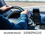 driver's hand on the steering... | Shutterstock . vector #1058396210
