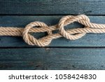 fisherman's knot. rope node. | Shutterstock . vector #1058424830