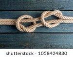 fisherman's knot. rope node. | Shutterstock . vector #1058424830