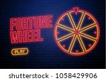 fortune wheel neon sign... | Shutterstock .eps vector #1058429906